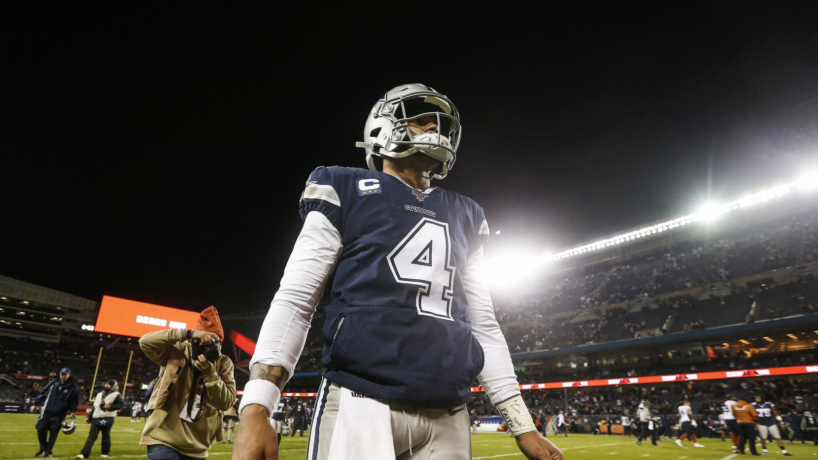 Dallas Cowboys quarterback Dak Prescott (4) exits the field following the Dallas Cowboys 31-24 loss to the Chicago Bears on Thursday, Dec. 5, 2019, at Soldier Field in Chicago.
