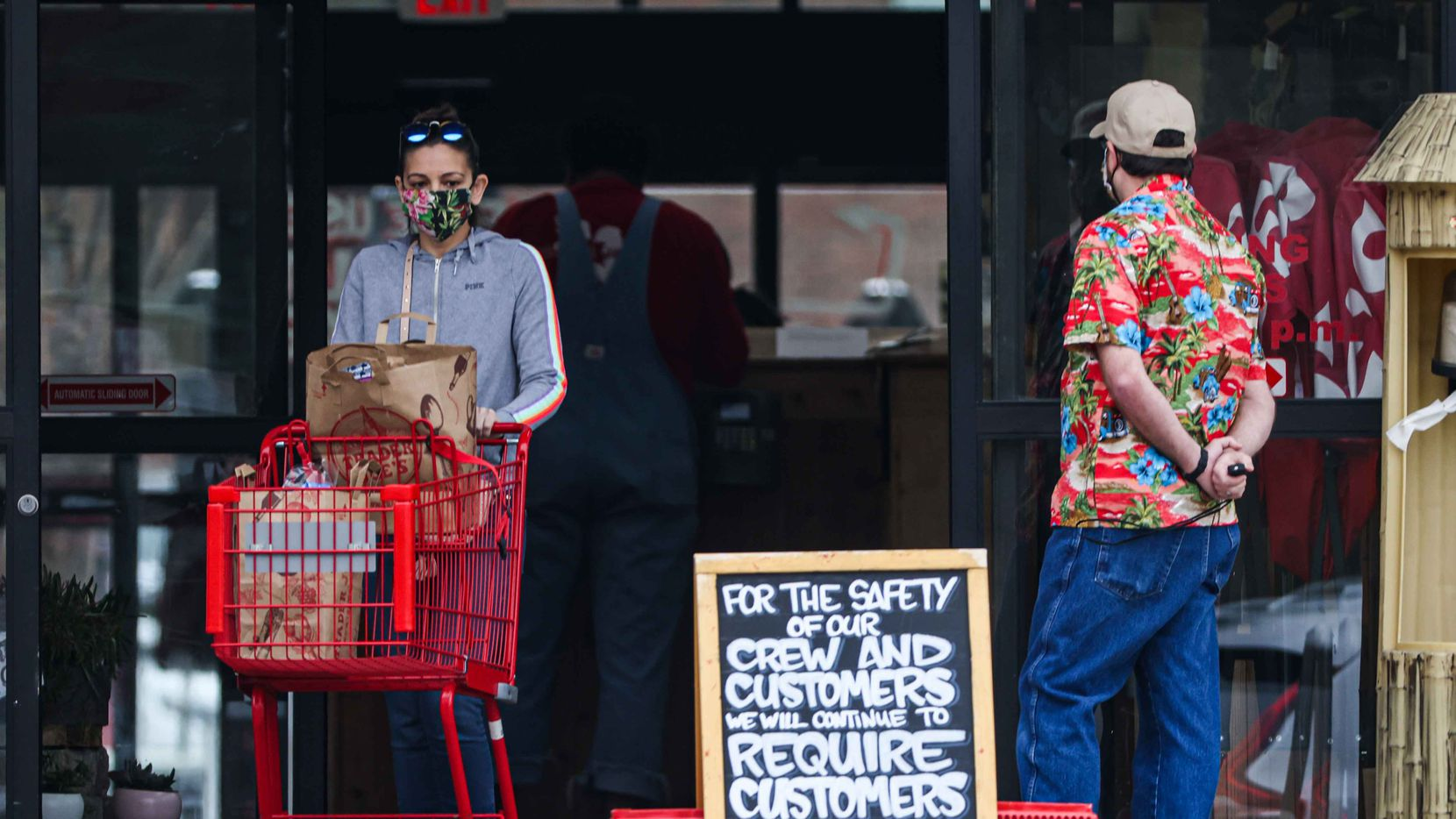 Shoppers at Trader Joe's on Greenville Ave wore masks even after COVID-19 mandates were lifted Wednesday in Texas.