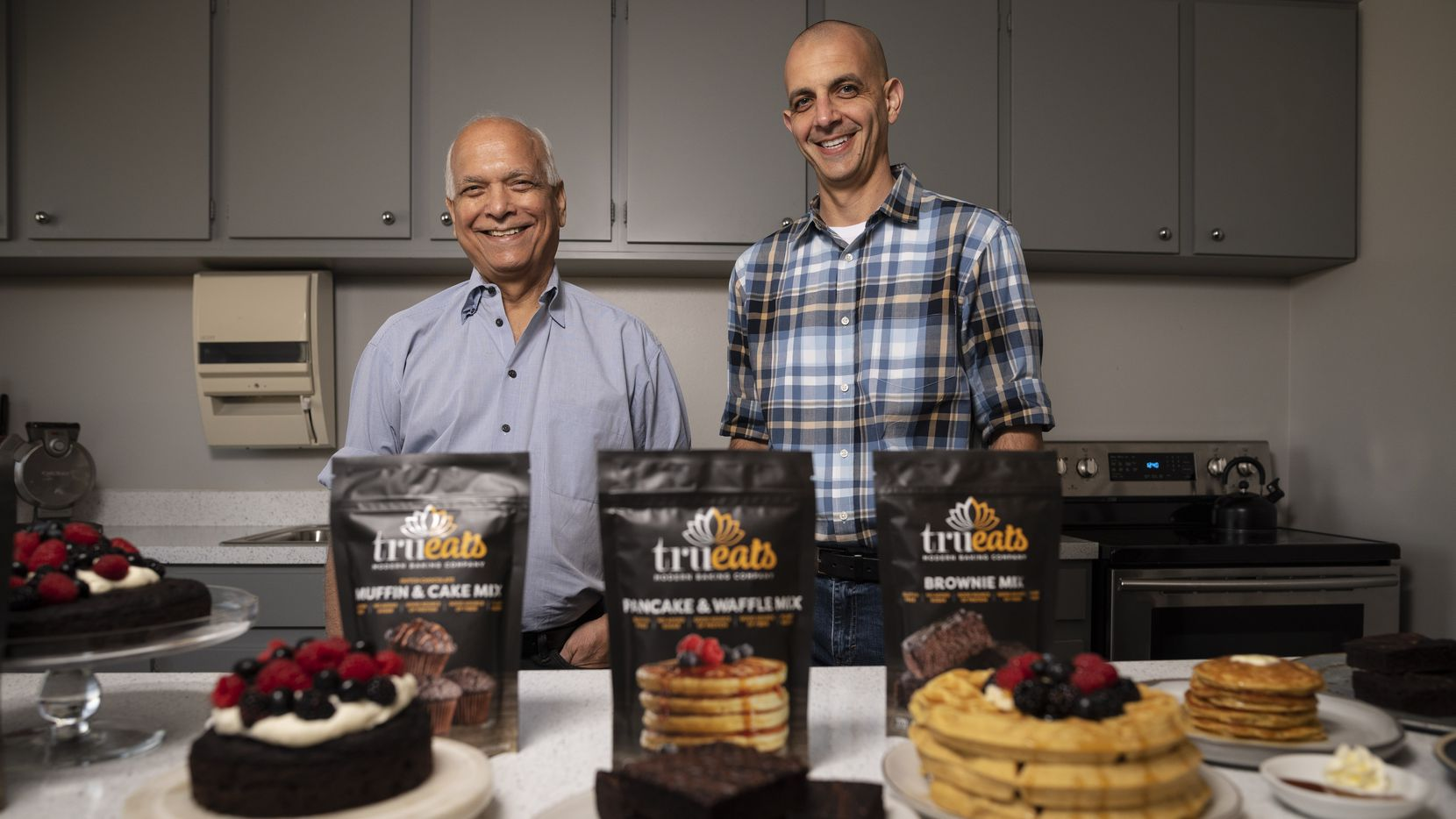 Surinder Kumar, left, CEO-Chief Innovation Officer, and his son Daven Kumar, Co-founder and CMO of Trueats Modern Baking Company, inside a research and development lab at Culinary Focus in Grand Prairie.