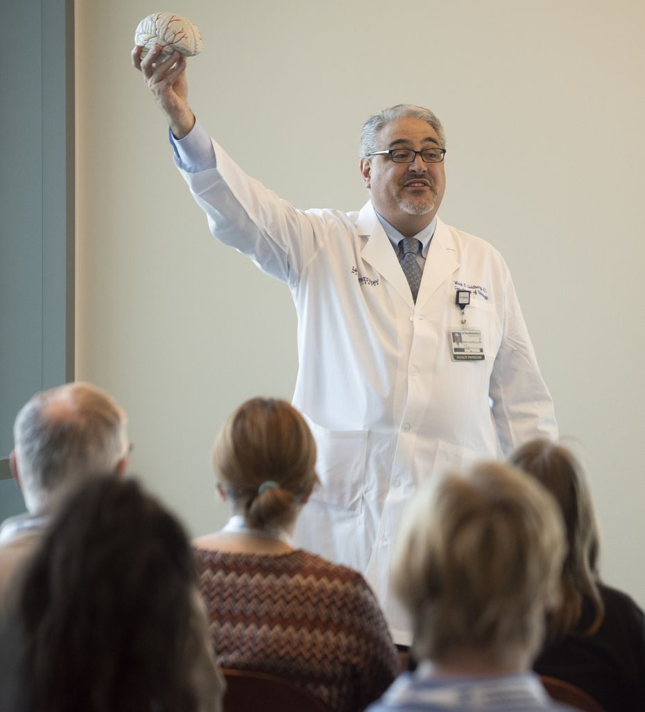 Neurologist Dr. Mark P. Goldberg, a professor at UT Southwestern Medical Center, gives an orientation to people before they take a tour of the Peter O'Donnell Jr. Brain Institute as part of Science in the City on Saturday, April 28, 2018.