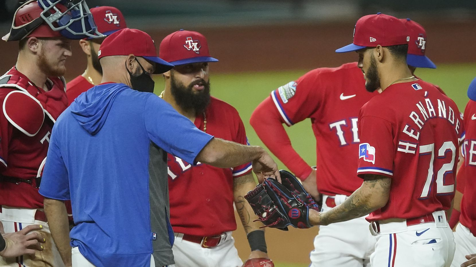 Texas Rangers manager Chris Woodward hands the ball over to pitcher Jonathan Hernandez after brining him in to pitch during the seventh inning against the Houston Astros at Globe Life Field on Friday, Sept. 25, 2020. (Smiley N. Pool/The Dallas Morning News)