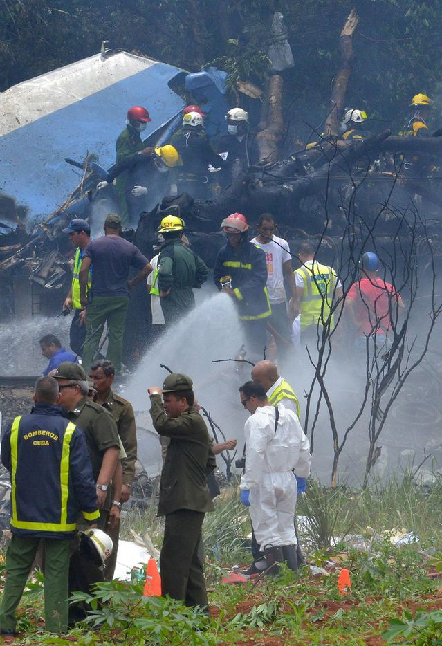 "Picture taken at the scene of the accident after a Cubana de Aviacion aircraft crashed after taking off from Havana's Jose Marti airport on May 18, 2018. A Cuban state airways passenger plane with 104 passengers on board crashed on shortly after taking off from Havana's airport, state media reported. The Boeing 737 operated by Cubana de Aviacion crashed ""near the international airport,"" state agency Prensa Latina reported. Airport sources said the jetliner was heading from the capital to the eastern city of Holguin."