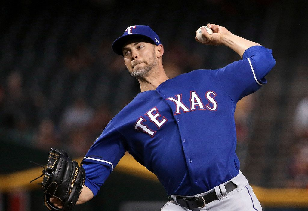 Texas Rangers starting pitcher Mike Minor throws to an Arizona Diamondbacks batter during the first inning of a baseball game Tuesday, April 9, 2019, in Phoenix. (AP Photo/Ross D. Franklin)