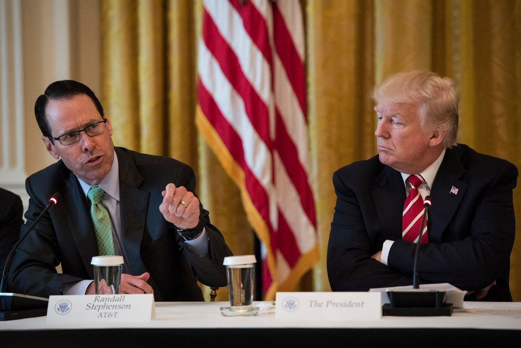 AT&T CEO/president/chairman/Big Kahuna Randall Stephenson (left) with President Donald Trump during an event at the White House in 2017.