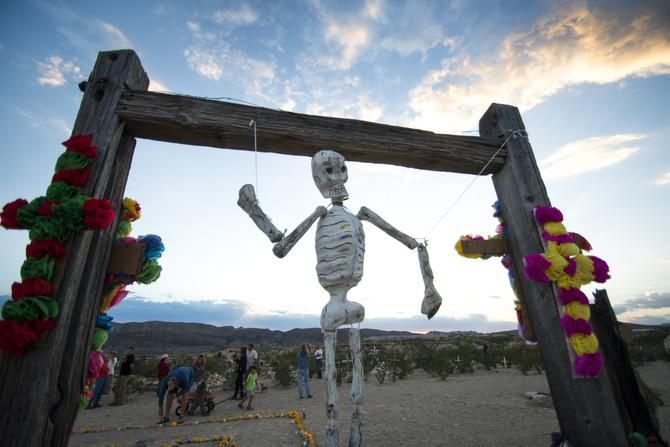 A makeshift skeleton dangles from one of the entrances to the Terlingua Ghost Town cemetery on the eve of Nov. 2, where townspeople gather each year to decorate the graves of dead loved ones. The annual ritual includes dinner and music furnished by residents of the tiny Big Bend community.