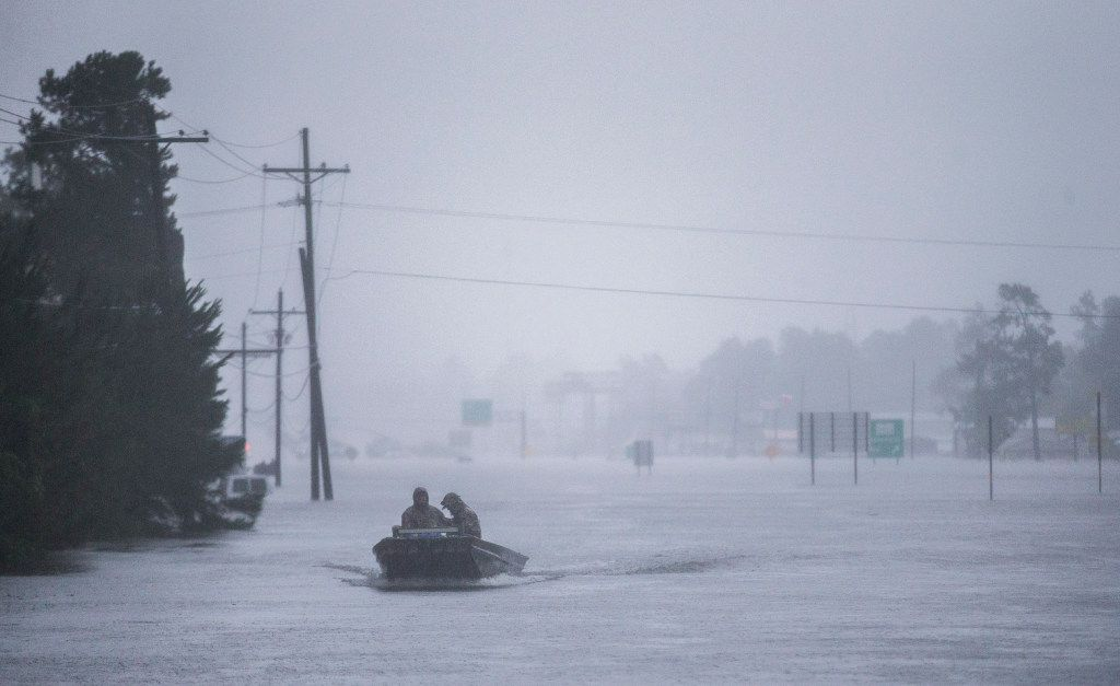 Emergency responders maneuvered a boat across flooded Highway 96 on Wednesday in Lumberton.