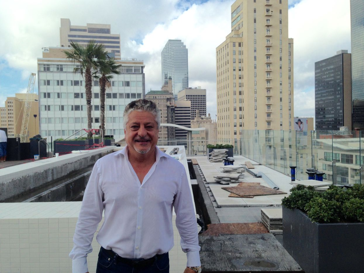 Developer Mehrdad Moayedi at the rooftop pool at the Statler Hotel.