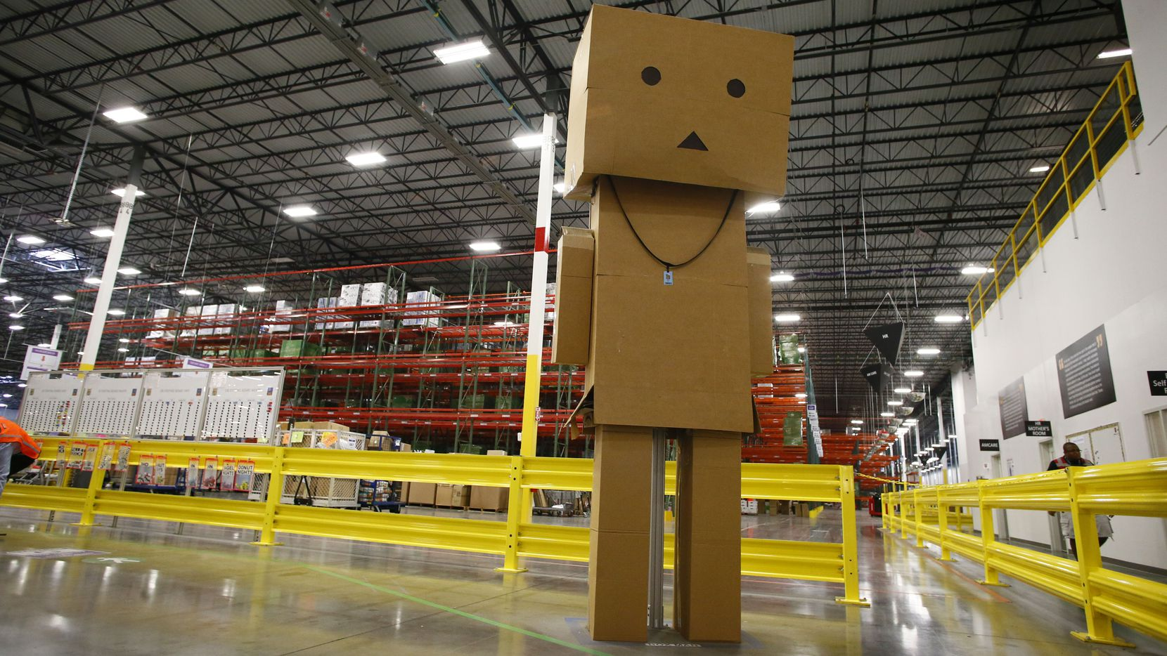A giant box man stands at the entrance of the Amazon fulfillment center in Coppell. Amazon was among the 91 large profitable companies that did not pay federal income tax in 2018, according to a recent report.