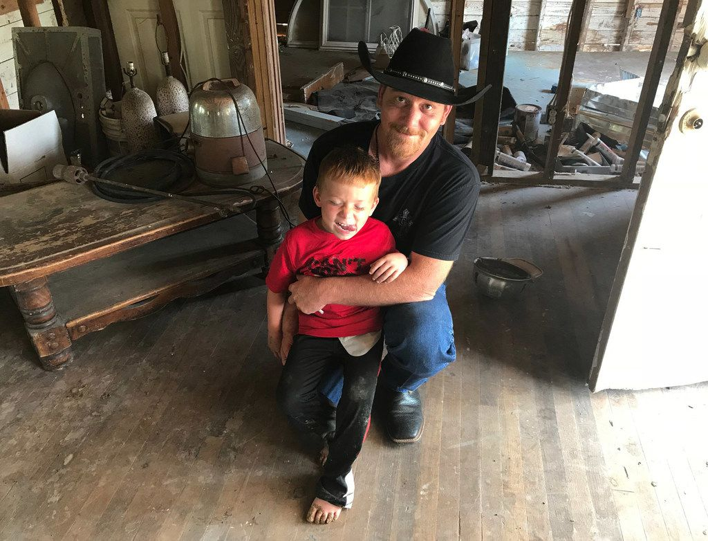 Chris Ward is pictured with his son, 6-year-old Ryland Ward, at the family home he and his brother are remodeling in La Vernia, Texas, on April 2, 2018. Ward lost his wife and two daughters in the shooting at the First Baptist Church of Sutherland Springs. Ryland, who was shot four times in the massacre, has undergone several surgeries and hours of physical therapy.
