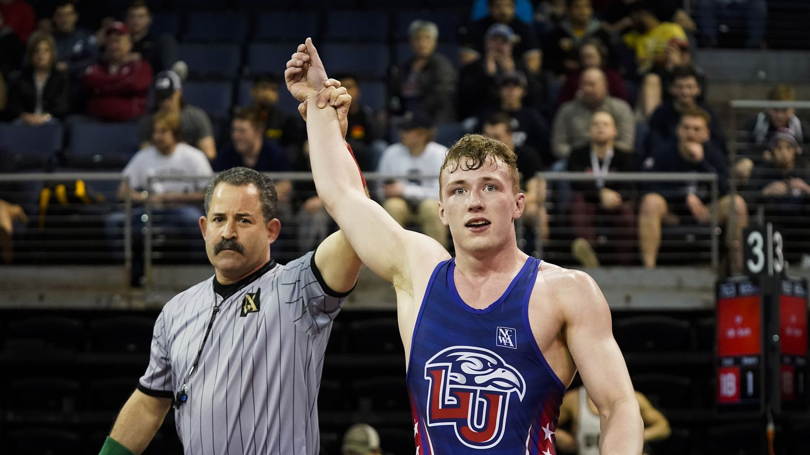 Joe Scott of Liberty University is acknowledges as the winner. The referee, against the tournament's protocol amid coronavirus concerns, elevated Scott's arms after the win during the NCWA national championships at the Allen Events Center on Friday, March 13, 2020, in Allen, Texas.
