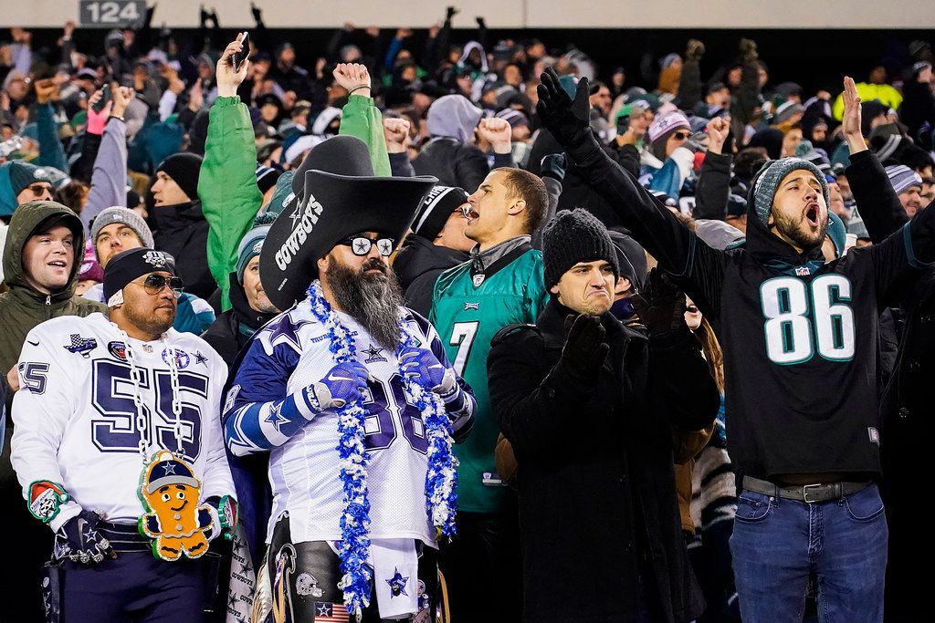 Philadelphia Eagles fans celebrate as two Dallas Cowboys fans look on in silence after a fourth-down pass from Cowboys quarterback Dak Prescott to wide receiver Michael Gallup fell incomplete during the second half of an NFL football game at Lincoln Financial Field on Sunday, Dec. 22, 2019, in Philadelphia. (Smiley N. Pool/The Dallas Morning News)