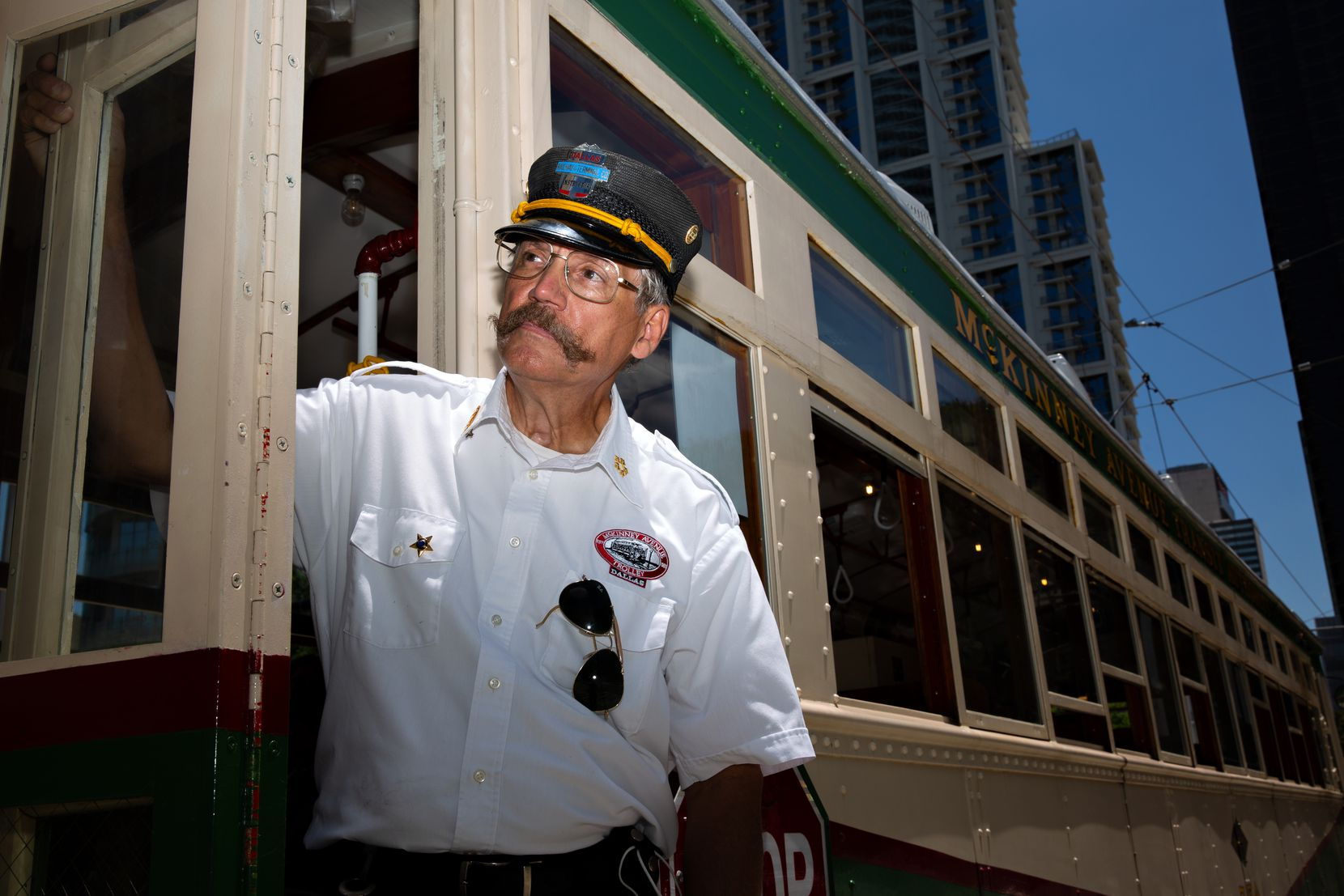 """John Landrum, vice president of operations, systems and technology for the McKinney Avenue Transit Authority, has over 38 years of experience in the streetcar business. He hops around in his duties, occasionally operating the streetcars himself. """"We're a very small organization, so everybody has to wear a lot of hats and be very capable,"""" he said."""