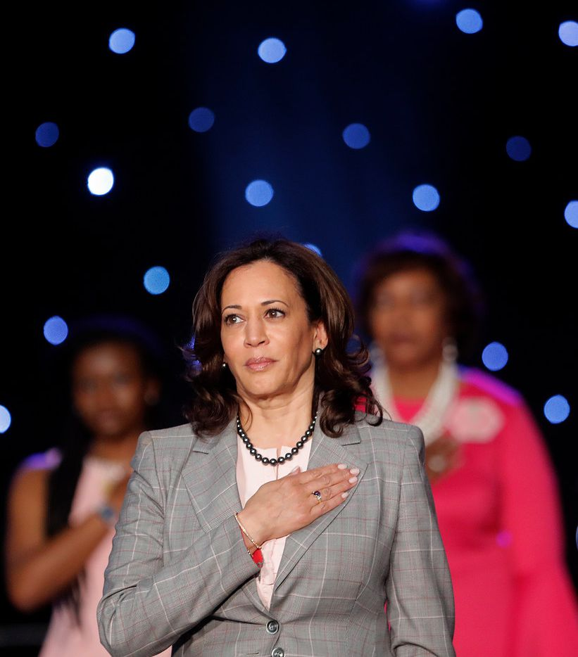Democratic Presidential Candidate Sen. Kamala Harris, D-Calif., holds her hand to her heart during the national anthem, before speaking at the Alpha Kappa Alpha Sorority South Central Regional Conference in New Orleans, Friday, April 19, 2019.