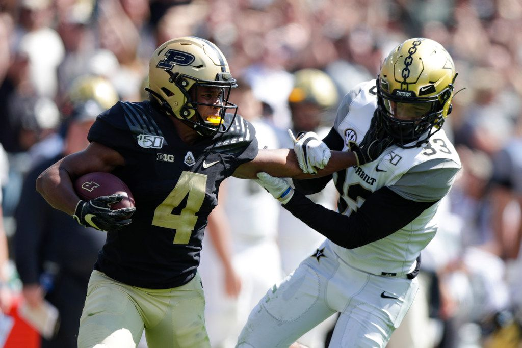 Purdue wide receiver Rondale Moore (4) holds off Vanderbilt safety Dashaun Jerkins (33) during the second half of an NCAA college football game in West Lafayette, Ind., Saturday, Sept. 7, 2019. Purdue defeated Vanderbilt 42-24. (AP Photo/Michael Conroy)