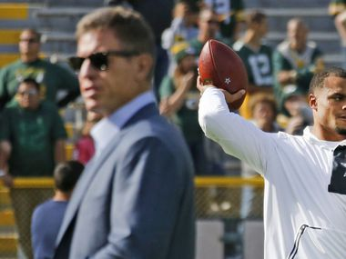 Troy Aikman, left, and Cowboys quarterback Dak Prescott, right, during early warmups before the Dallas Cowboys vs. the Green Bay Packers at Lambeau Field in Green Bay, Wisconsin, on Sunday, October 16, 2016.
