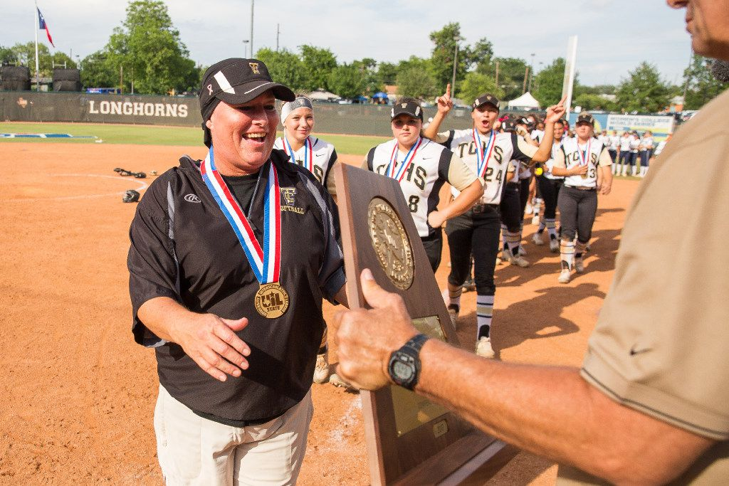 The Colony coach Deana Coleman, left, receives the state championship trophy at McCombs Field in Austin, Texas on Saturday June 3, 2017. The Colony defeated Willis 5-2. (Julia Robinson/Special Contributor)