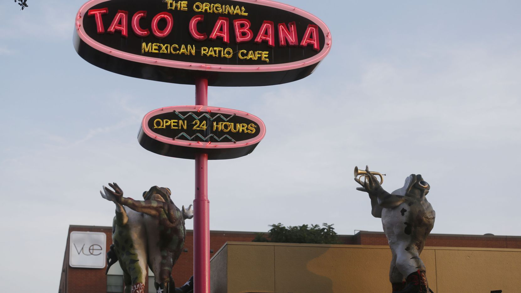 Three of the original Six Frogs Over Tango sculptures on top of the Taco Cabana in Lower Greenville Avenue in Dallas, Texas on June 28, 2014.