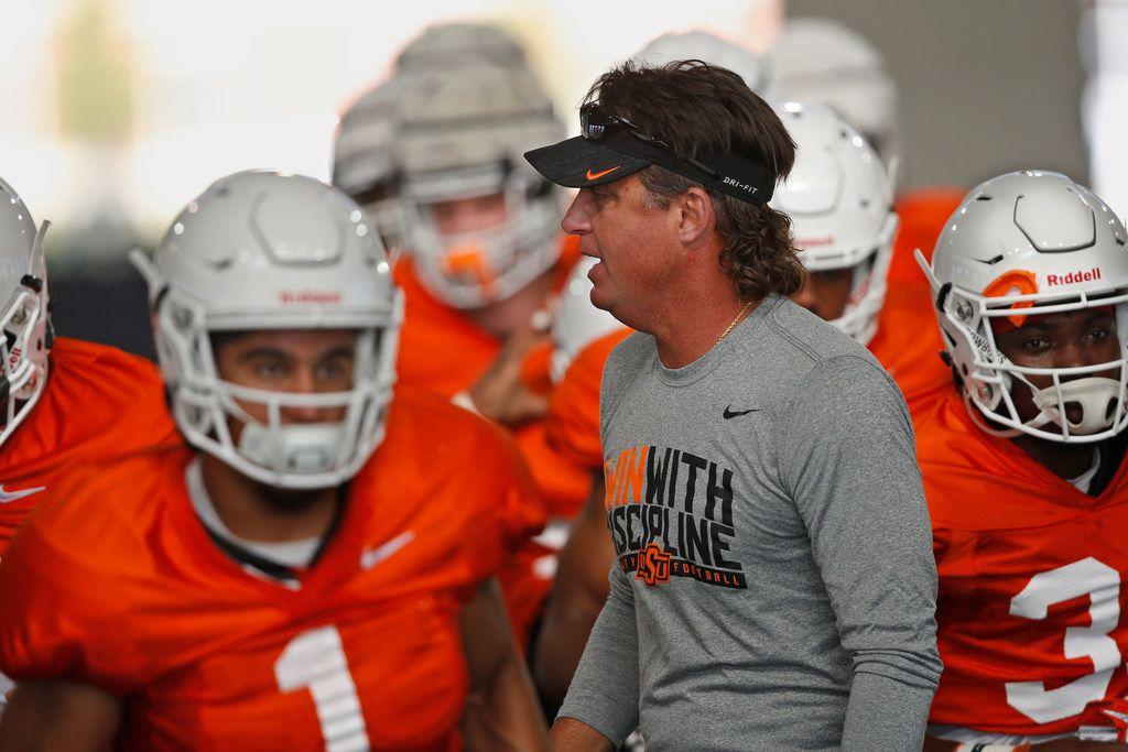 Oklahoma State head coach Mike Gundy during an NCAA college football practice in Stillwater Okla., Tuesday, Aug. 6, 2019. (AP Photo/Sue Ogrocki)