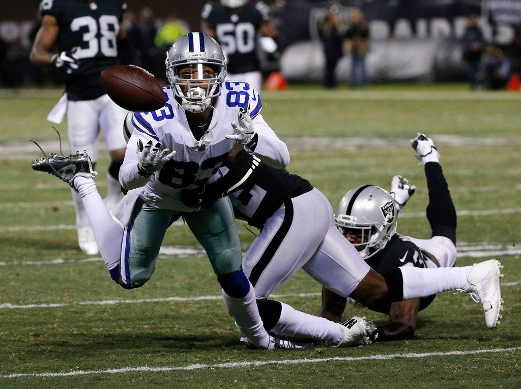 Dallas Cowboys wide receiver Terrance Williams (83) misses a catch against Oakland Raiders strong safety Karl Joseph (42) in the third quarter at OaklandÐAlameda County Coliseum in Oakland, California on Sunday, Dec. 17, 2017. (Rose Baca/The Dallas Morning News)