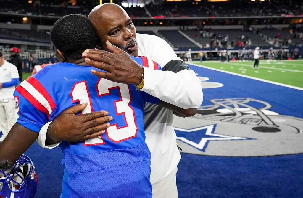 Duncanville head coach Reginald Samples hugs wide receiver Roderick Daniels (13) after the PanthersÕ victory over Arlington Martin in a Class 6A Division I Region I semifinal playoff football game at AT&T Stadium non Friday, Nov. 29, 2019, in Arlington. (Smiley N. Pool/The Dallas Morning News)