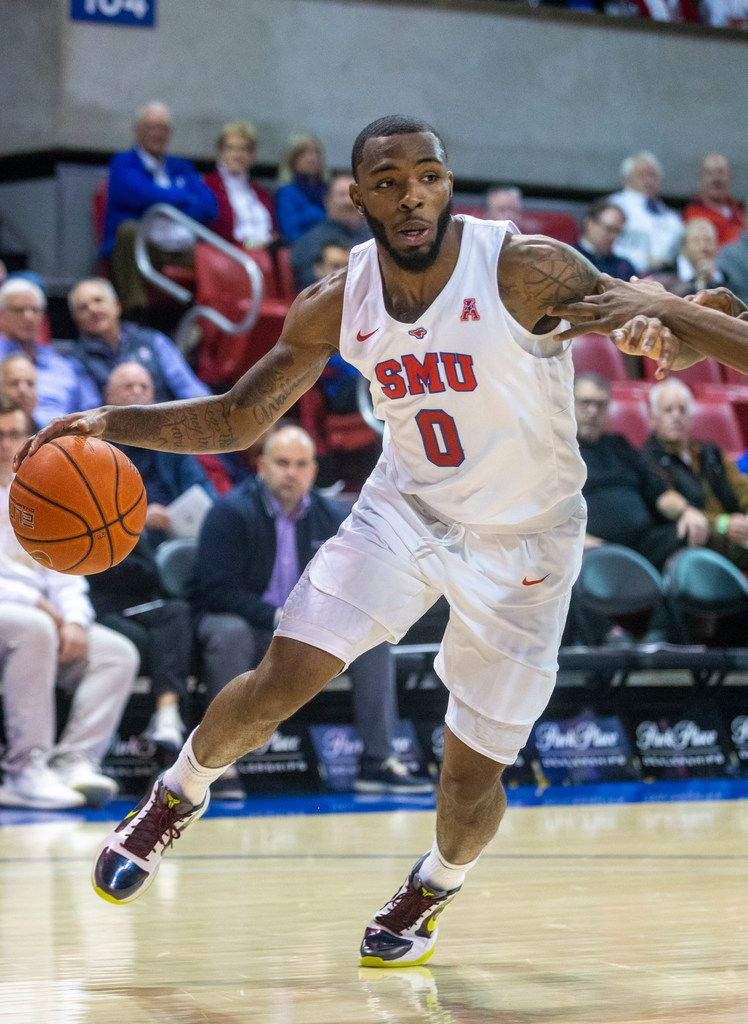 Southern Methodist Mustangs guard Tyson Jolly (0) drives the ball past defenders in the first half of an NCAA basketball game between the SMU Mustangs and the University of Central Florida Knights at Moody Coliseum in University Park, Texas, on Wednesday, Jan. 8, 2020.