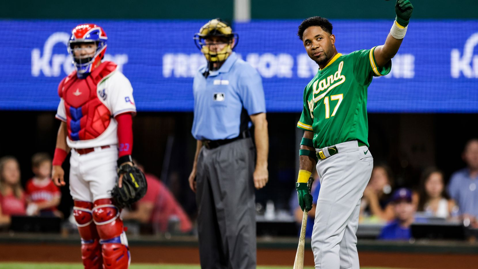 Oakland Athletics' Elvis Andrus (17) acknowledges the fans before his first at bat during the second inning of a baseball game against the Texas Rangers in Arlington, Monday, June 21, 2021.
