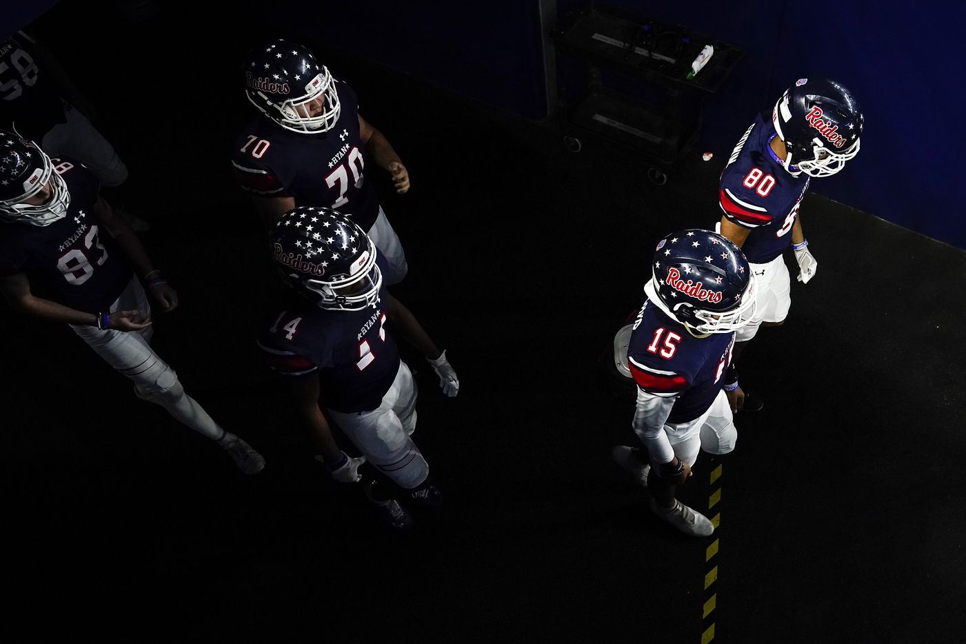 Denton Ryan players take the field to face Cedar Park in the Class 5A Division I state football championship game at AT&T Stadium on Friday, Jan. 15, 2021, in Arlington, Texas. (Smiley N. Pool/The Dallas Morning News)