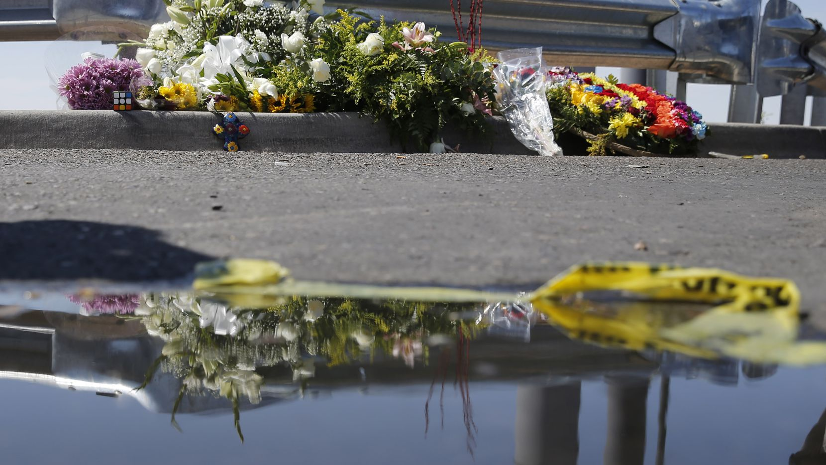 Flowers and other items near an entrance to the Walmart in El Paso, Texas on Sunday, August 4, 2019. 20 people were shot and killed and 26 more were wounded at a Walmart in El Paso on Saturday. (Vernon Bryant/The Dallas Morning News)