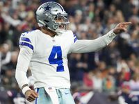 Dallas Cowboys quarterback Dak Prescott (celebrates after throwing a a 1-yard touchdown  pass to wide receiver CeeDee Lamb during the third quarter of an NFL football game against the New England Patriots on Sunday, Oct. 17, 2021, in Foxborough, Mass.