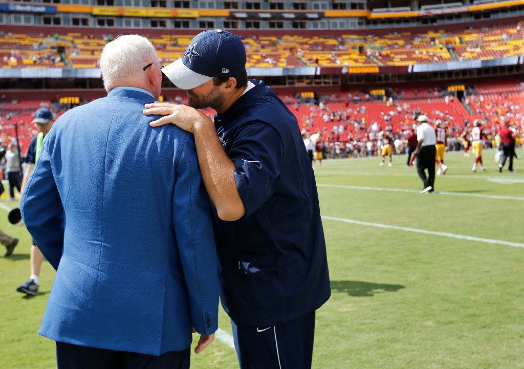 Dallas Cowboys quarterback Tony Romo (9) talks to Dallas Cowboys owner and general manager Jerry Jones before a game against the Washington Redskins at FedEx Field in Landover, Maryland on Sunday, September 18, 2016. (Vernon Bryant/The Dallas Morning News)