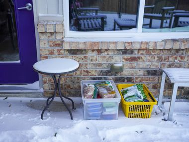 Contents of a home freezer rest in the snow on the outside patio of a home in Richardson after a winter storm brought snow and freezing temperatures to North Texas on Monday, Feb. 15, 202.  More than 2 million Texans were without power after the winter storm prompted outages.  With temperatures in the teens, and headed in to the single digits, some residents used the colder outside conditions to keep food from spoiling inside their relatively warmer homes.