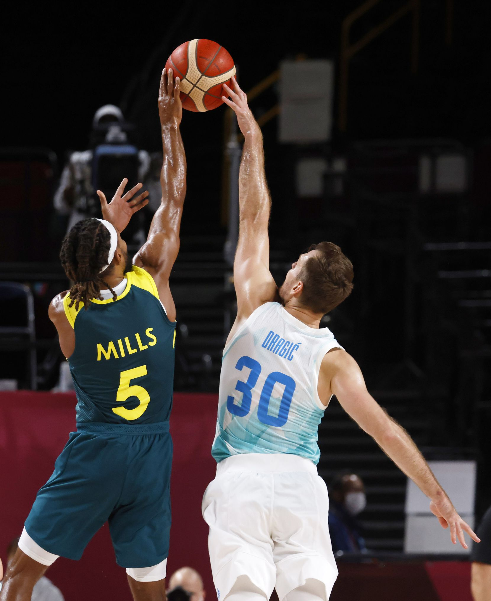 Slovenia's Zoran Dragic (30) blocks a shot attempt from Australia's Patty Mills (5) during the second quarter of play in the bronze medal basketball game at the postponed 2020 Tokyo Olympics at Saitama Super Arena, on Saturday, August 7, 2021, in Saitama, Japan. (Vernon Bryant/The Dallas Morning News)