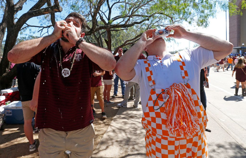 Texas A&M fan Jarrett Bennett (left) and Tennessee fan Chris Turner drink beer prior to the SEC game at Kyle Field in College Station, Texas, Saturday, Oct. 8, 2016. (Jae S. Lee/The Dallas Morning News)