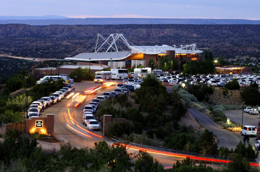 A line of cars heads toward the open-air Santa Fe Opera house, located in the foothills outside of the city.