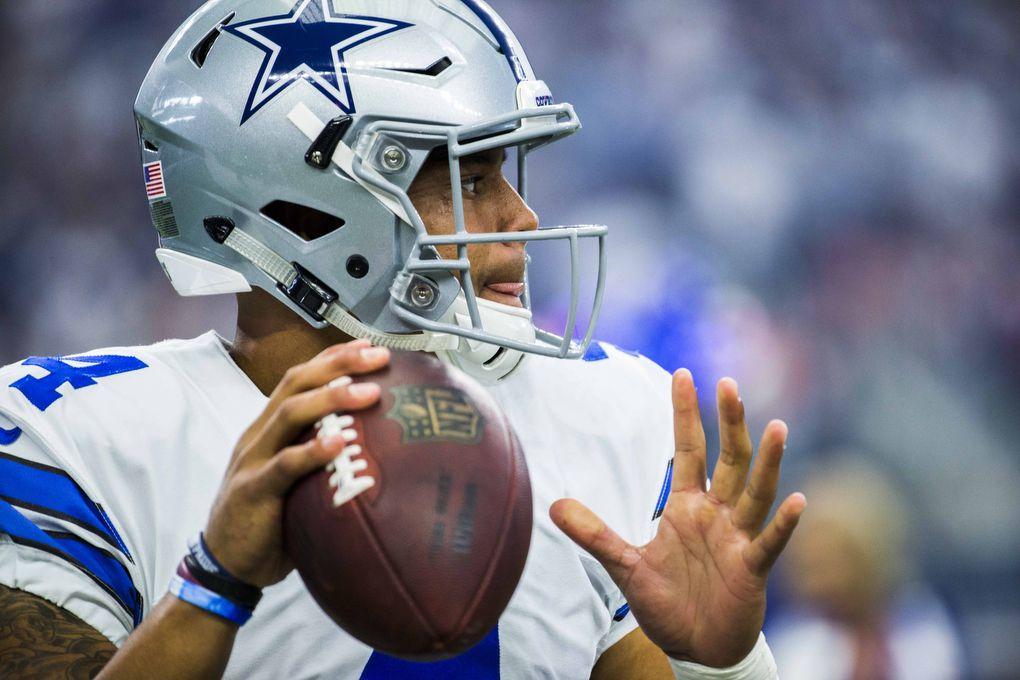 Dallas Cowboys quarterback Dak Prescott (4) warms up before their game against the Cincinnati Bengals on Sunday, October 9, 2016 at AT&T Stadium in Arlington, Texas.