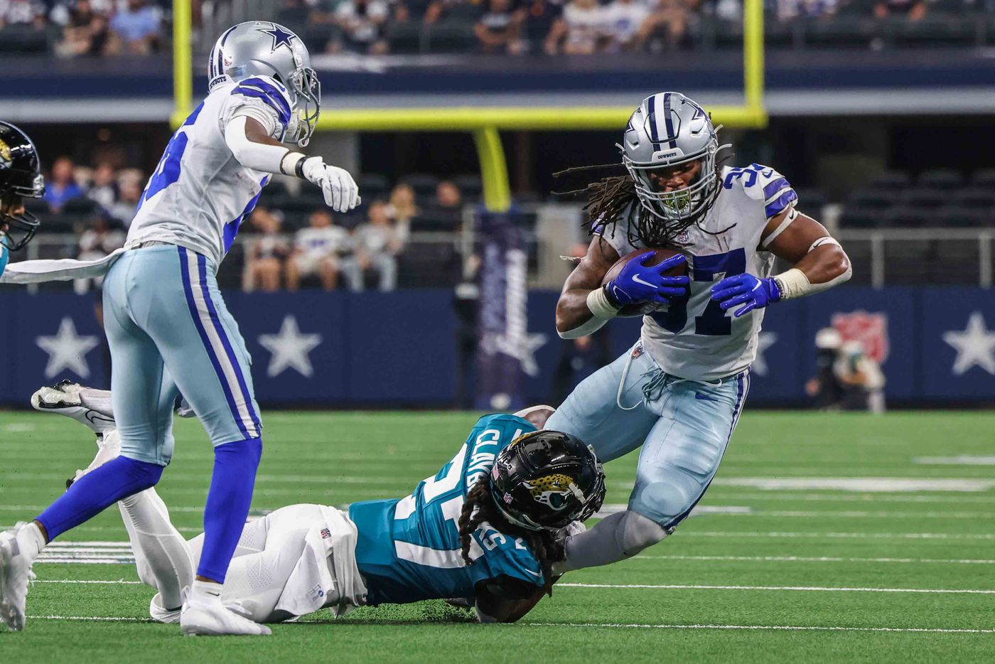 Dallas Cowboys' offense JaQuan Hardy, 37, trips over Jacksonville Jaguars' Chris Claybrooks, 27, during the 2nd quarter of a preseason game against Jacsonville Jaguars at AT&T stadium in Arlington on Sunday, August 29, 2021. (Lola Gomez/The Dallas Morning News)