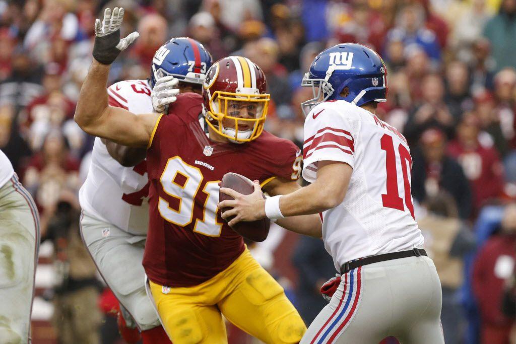 Nov 29, 2015; Landover, MD, USA; New York Giants quarterback Eli Manning (10) is sacked by Washington Redskins outside linebacker Ryan Kerrigan (91) in the second quarter at FedEx Field. Mandatory Credit: Geoff Burke-USA TODAY Sports