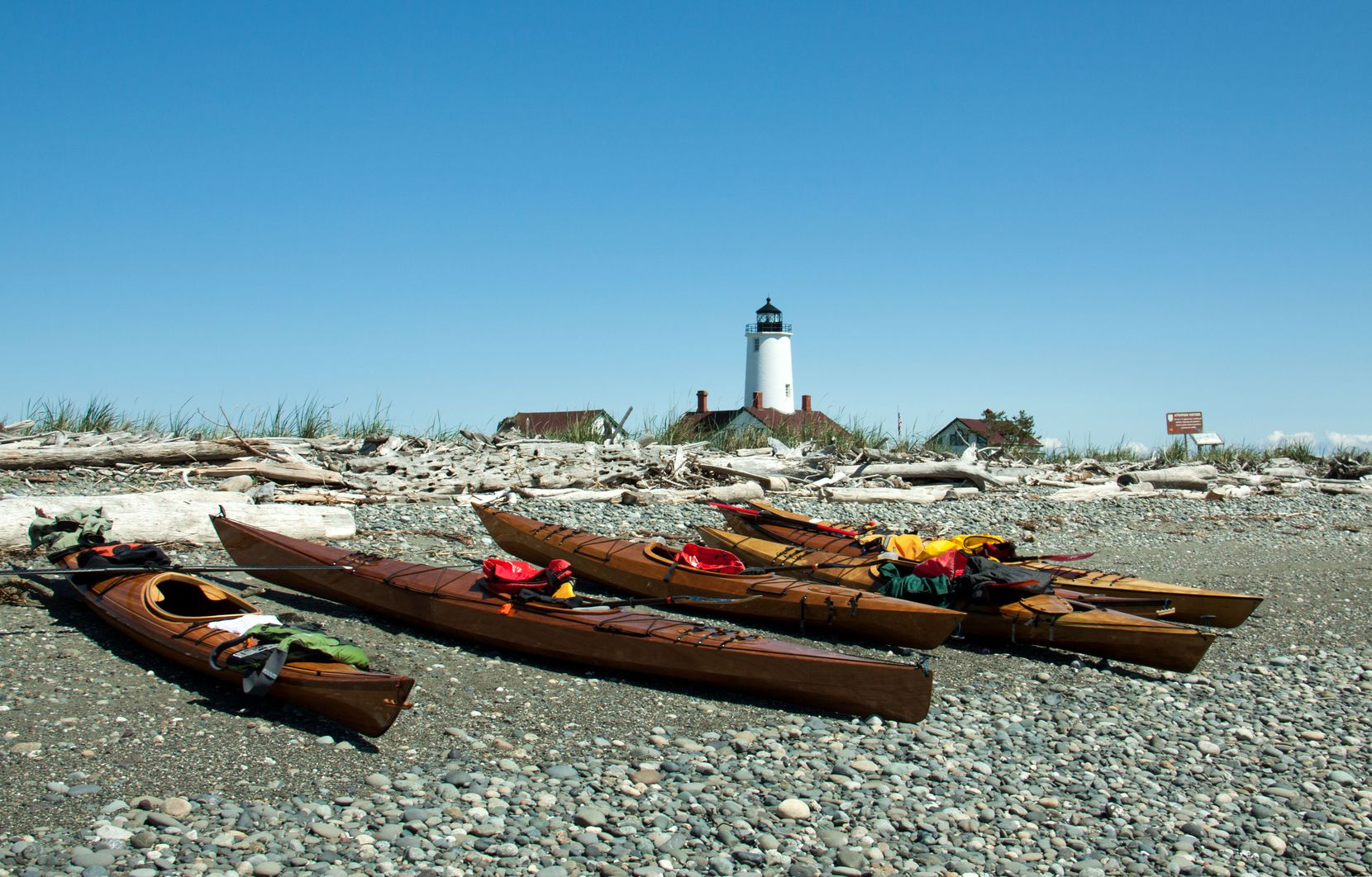 At Washington state's New Dungeness Lighthouse, visitors can handle light maintenance tasks — and enjoy kayaking and other recreational activities in their downtime.
