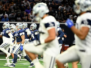 Dallas Cowboys players warmup during practice at Ford Center at The Star, Monday, Aug. 16, 2021, in Frisco, Texas.