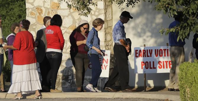 Voters stand in line at an early voting polling site recently in San Antonio. The U.S. Supreme Court this weekend gave Texas permission to enforce a contested voter ID law for the Nov. 4 election. Sounding Off contributors voiced mixed opinions about the ruling.