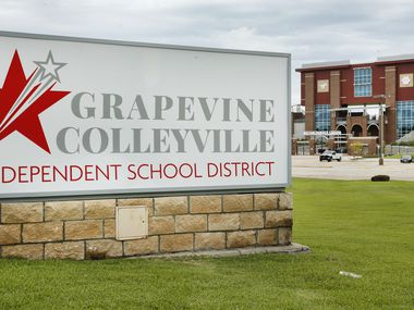 The Grapevine-Colleyville ISD sign is pictured before Mustang Panther Stadium in Grapevine, Texas, Tuesday, June 23, 2020. (Tom Fox/The Dallas Morning News)