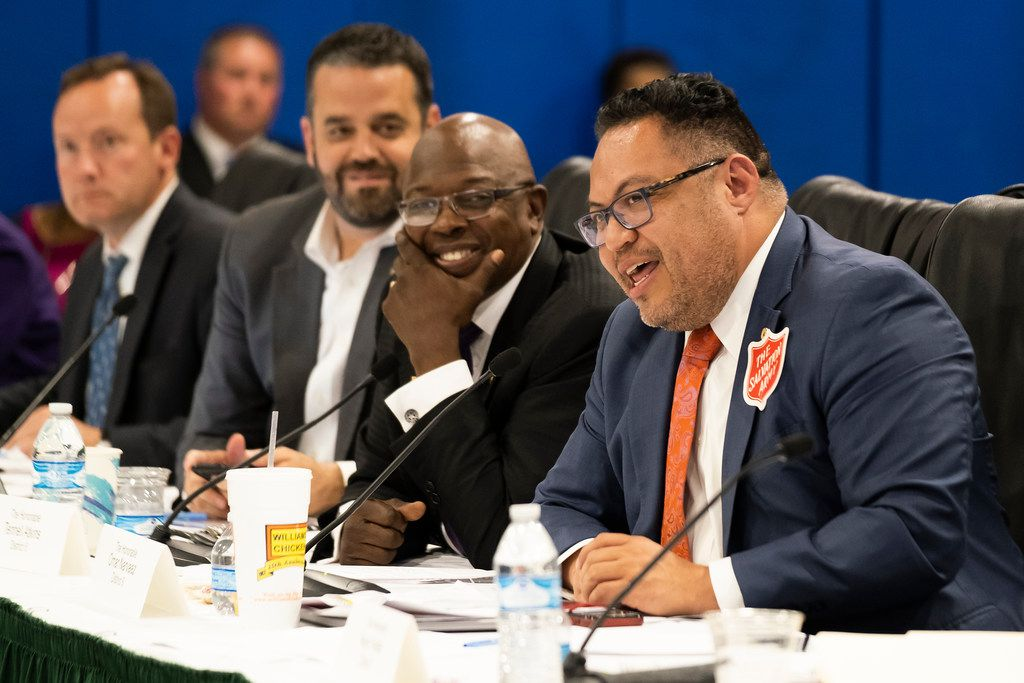 Dallas City Council member Omar Narvaez dons a Salvation Army sticker as he speaks in favor of the organization's proposed 20-acre campus along an industrial corridor of Stemmons Freeway.