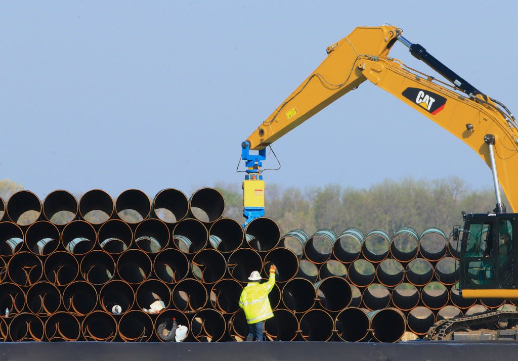 FILE - In this May 9, 2015 file photo, pipes for the proposed Dakota Access oil pipeline that will stretch from the Bakken oil fields in North Dakota to Illinois are stacked at a staging area in Worthing, S.D. Construction on the pipeline is now underway in North Dakota, South Dakota and Illinois, three of the four states that will carry the oil from western North Dakota. The pipeline also will cross Iowa, but regulators there have declined to act quickly on a request to allow Texas-based Energy Transfer Partners to begin construction in that state. (AP Photo/Nati Harnik, File)