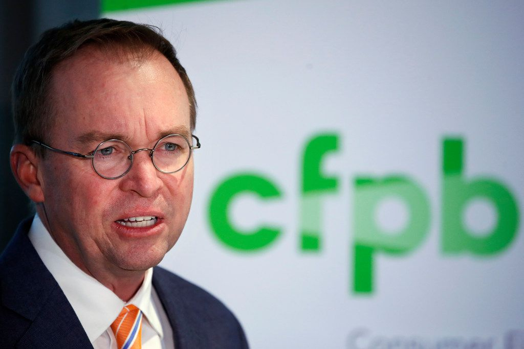 Mick Mulvaney speaks during a news conference after his first day as acting director of the Consumer Financial Protection Bureau on Monday.