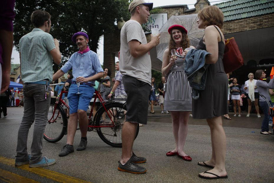 Max Rasor, left, Colin Clarke, second from left, Timmy Martin, center, Andee Pittman and Christa Martin, right, chat during Bastille on Bishop on July 14, 2013 on Bishop Ave. in Dallas. The festival featured outdoor markets, wine tastings, music, dancing and games to celebrate French culture and the arts in Dallas.