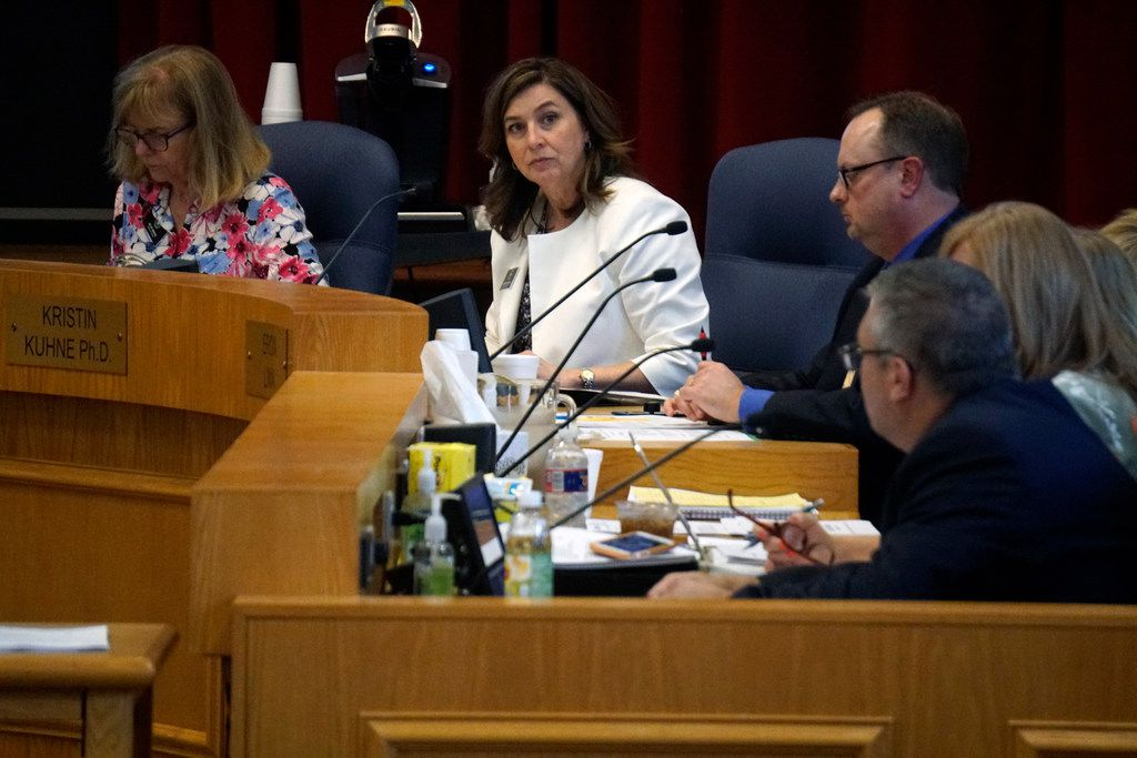 Richardson ISD's school board member Kristin Kuhne (far left) speaks about the tax ratification election during a board meeting on Aug. 20.