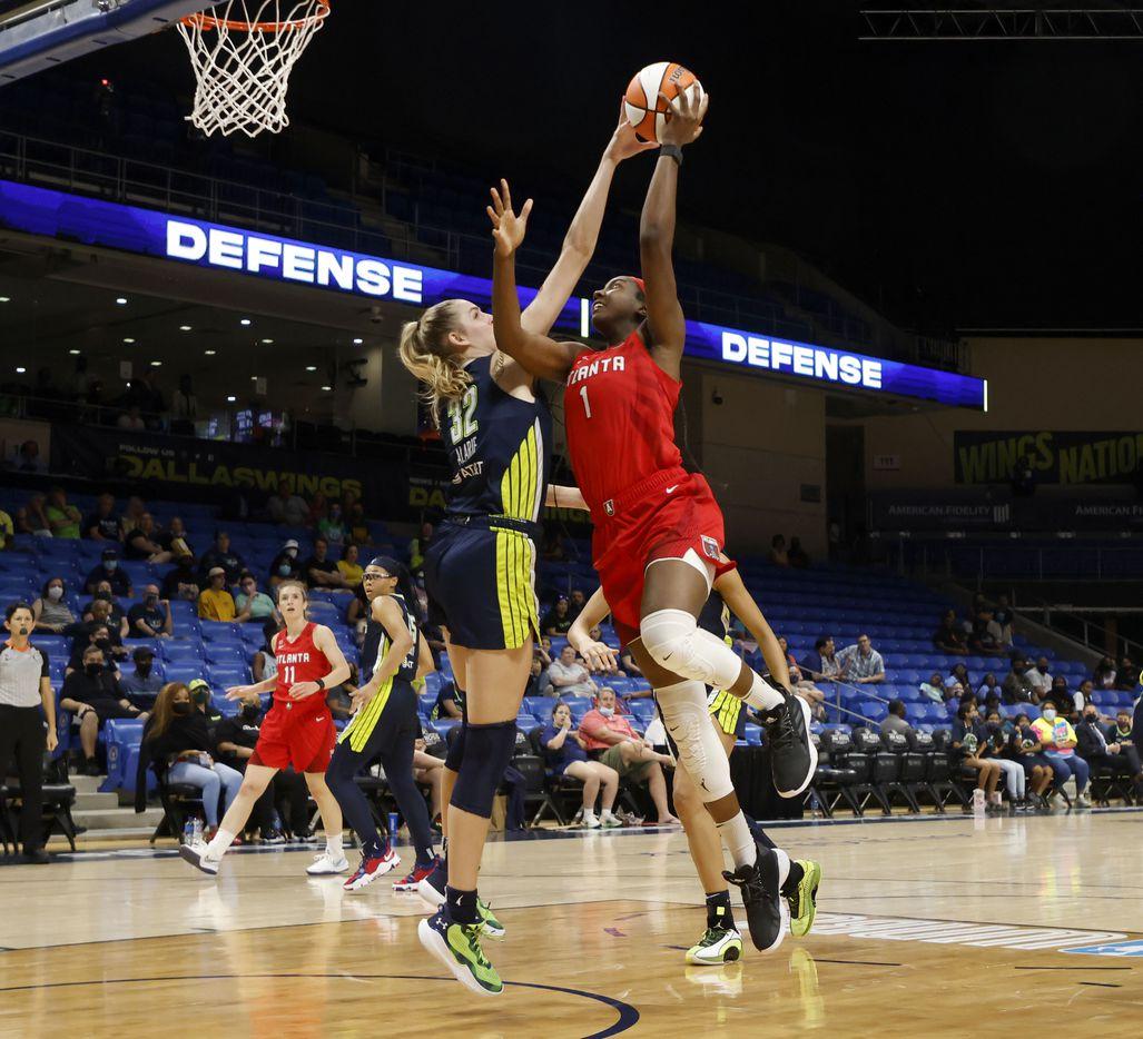 Dallas Wings center/forward Bella Alarie (32) blocks a shot by Atlanta Dream center/forward Elizabeth Williams (1) during the second half of their WNBA basketball game in Arlington, Texas on Sept. 2, 2021. Dallas won 72-68. (Michael Ainsworth/Special Contributor)