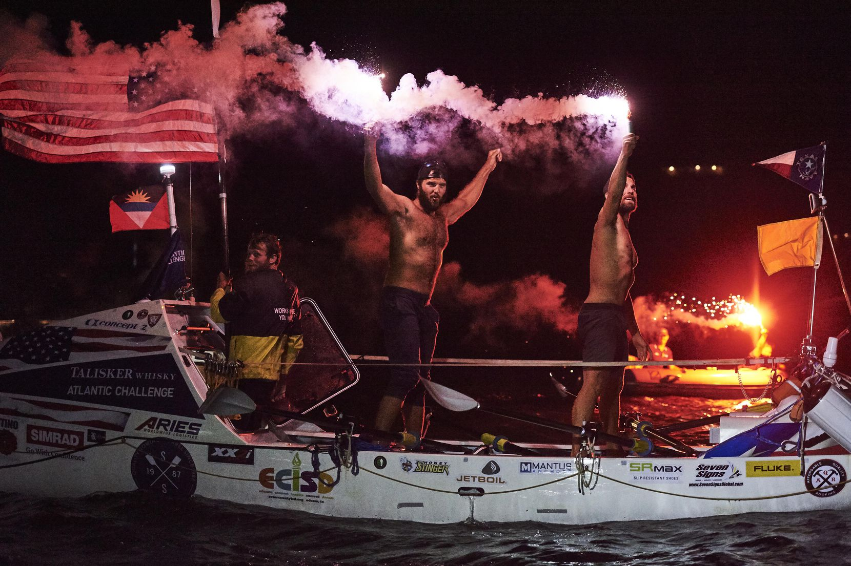 After their history-making row across the Atlantic Ocean, the team members fired flares in celebration as they reached Nelson's Dockyard English Harbor, about 300 miles east of Puerto Rico. From left are Matson, Krauskopf and Alviar.