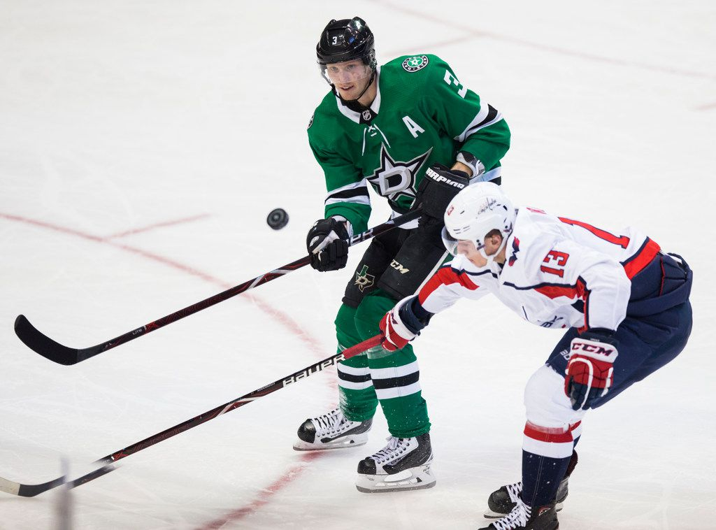Dallas Stars defenseman John Klingberg (3) lands a flying puck with Washington Capitals left wing Jakub Vrana (13) during the second period of an NHL game between the Dallas Stars and the Washington Capitals on Friday, January 4, 2019 at the American Airlines Center in Dallas. (Ashley Landis/The Dallas Morning News)