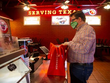 French hornist Brian Brown picks up a DoorDash order from Soulman's Bar-B-Que in Hurst.